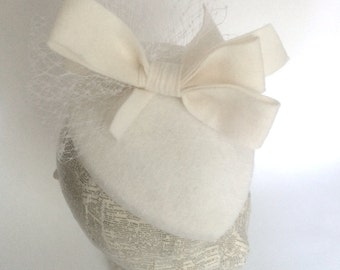 White bridal teardrop fascinator with felt bow and veiling