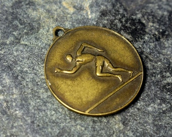 Vintage  Antique Brass Pendant. Greek Olympics Pendant. Ancient Greece Athlete Embossed Brass Pendant.