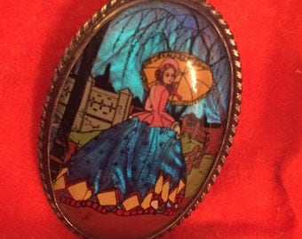 Beautiful brooch with ladyunder parasol