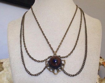 Real taxidermy eye necklace