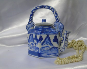 Blue and White Chinese Teapot with mountain side scene