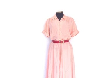 Retro midi dress with cuffed arm and neck embroidery cut out design. 70's vintage peach colored office dress