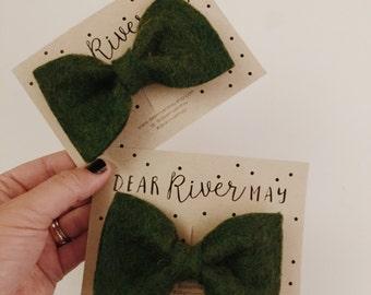 Dark green bow tie