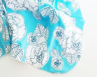 Blue floral flannel swaddle blanket