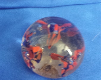 Small coloured paperweight .