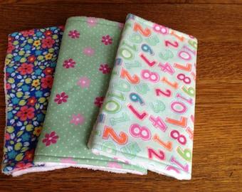 Three flannel burp cloths. Pink, green and blue burp cloths.