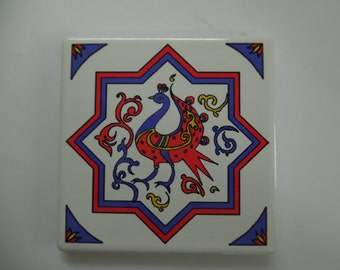 Four coasters based on a Mamluk design inspired by of the old city Jerusalem architecture with a beautiful Armenian bird of prosperity.