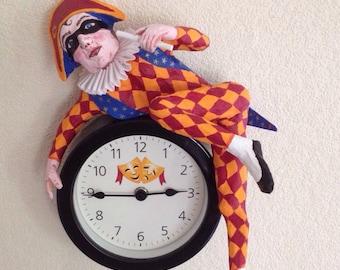 Wall clock. Theatrical Harlequin design.