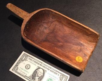 Wooden scoop with handle