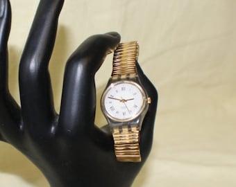 ON SALE Unusual Swatch Swiss Wrist Watch #227 Gold Flex Metal Band Roman Numerals NO 3 o'clock