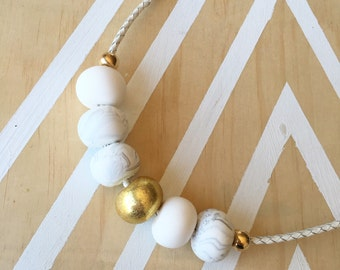 "Polymer clay bead necklace. Marble, gold, white ""the mel on braided leather"""