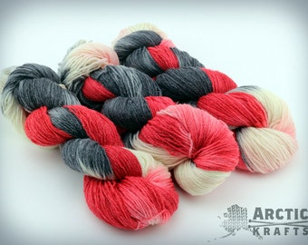 Queen of hearts hand dyed sock weight yarn. 410 yards