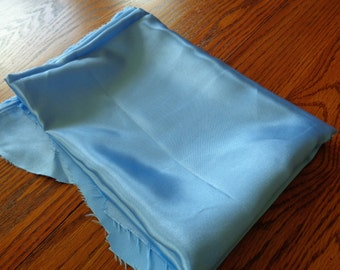 3/4 yard of cornflower blue costume weight satin but with damage