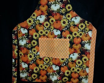 Beautiful Fall apron with sunflowers and pumpkins.  Reversible
