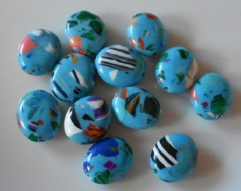 Pack of 12 synthetic howlite oval beads, pale blue multi