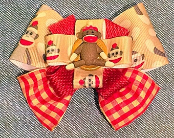Sock Monkey Bow on a crochet headband