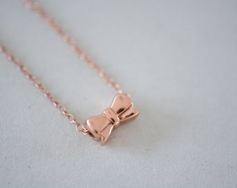 Dainty rose gold vermeil necklace with bow pendant