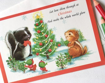 Vintage Christmas Card. Vintage Holiday Card. Retro Greeting Card. Baby Skunk and Baby Chipmunk with Christmas Tree.