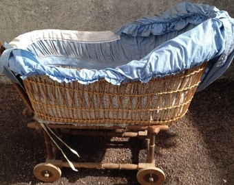 French Vintage Wicker Crib On Wooden Wheel Base