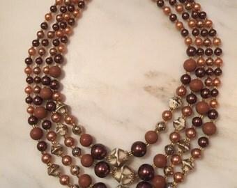 Vintage Japan four strand beaded becklace