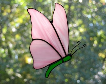 Stained glass butterfly suncatcher with pink wings and green body 5 x 7