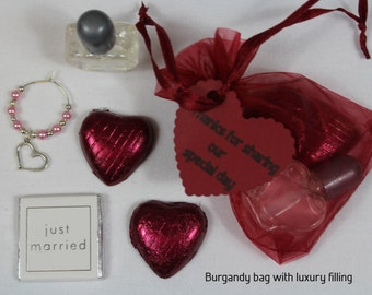 Burgandy wedding favour bags with a selection of fillings - heart, butterfly, flower or lovebird theme