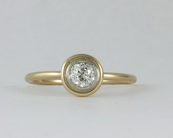 Handmade Antique 0.35 carat old European diamond platinum 18 kt engagement ring. Center is Edwardian circa 1900.