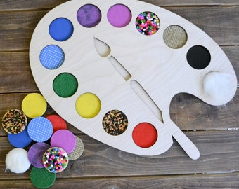 Sensory game. Palette with tactile material. Game for children