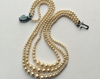 Vintage multi-strand graduated faux Pearl Necklace .