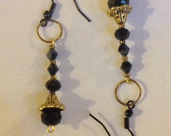 Black swarovski with gold dangle earrings