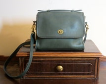 Coach Court Bag In Green Leather With Brass Hardware Adjustable Crossbody Strap Made In United States- Fade Lines