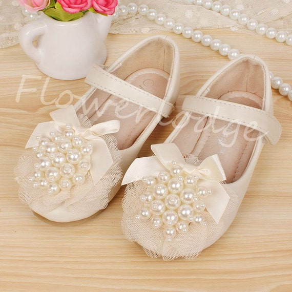 We have an awesome assortment of ballet flower girl shoes that are perfect for keeping toddlers and little girls comfy and cute throughout the ceremony and reception. These toddler satin ballet slippers come in multiple colors, including white, silver, black, gold and pink, for a .