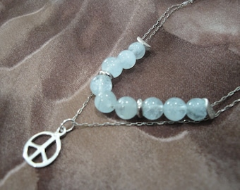 Aquamarine multi-chain sterling silver necklace, with sterling peace sign charm.