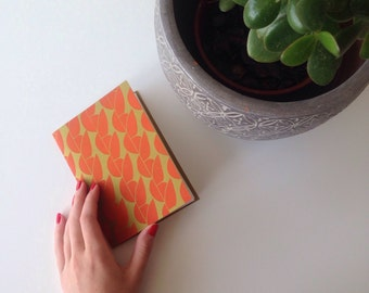 Lino Printed and Hand Bound A6 Notebook 'Greengage' Print in Tangerine Orange and Lime