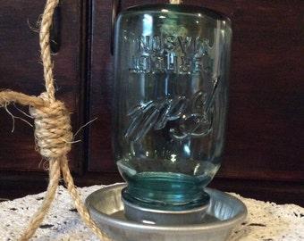 Hanging bird feeders from antique Mason jars