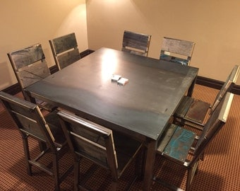 Modern steel table with eight pioneer chairs.