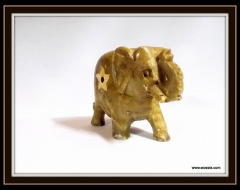 Hand polished Asian elephant made of (sard) onyx.