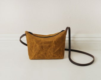 Mini brown waxed canvas crossbody bag with leather straps