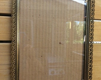 Vintage 8 X 10 ornate brass frame. Hollywood Regency.