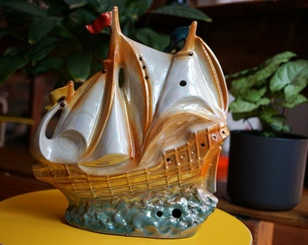 Vintage 1950's ceramic sailing ship collectable. Bronzed highlights with mother of pearl sheen.