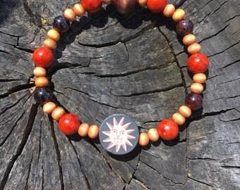 Coral and garnet sun bracelet.