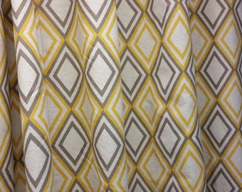 Two curtain panels 75W x 64L grommet top, lined drapes, extra Diamond pattern yellow, taupe on oatmeal linen background