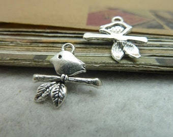 50 Bird Charms Antique Silver Tone Sitting on a Branch