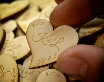 Custom engraved wooden hearts. These hearts for perfect for wedding receptions or parties.