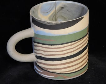 Hand built mug with colored clay swirls