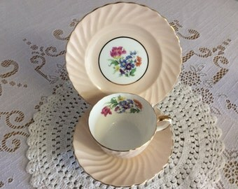 Vintage Aynsley trio pink swirl design with delicate flowers inside
