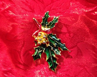 Vintage Holly Leaf pin with red bow and gold berries.  Holly leaves are green enamel outlined in gold.