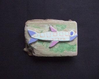 fish mosaic on driftwood