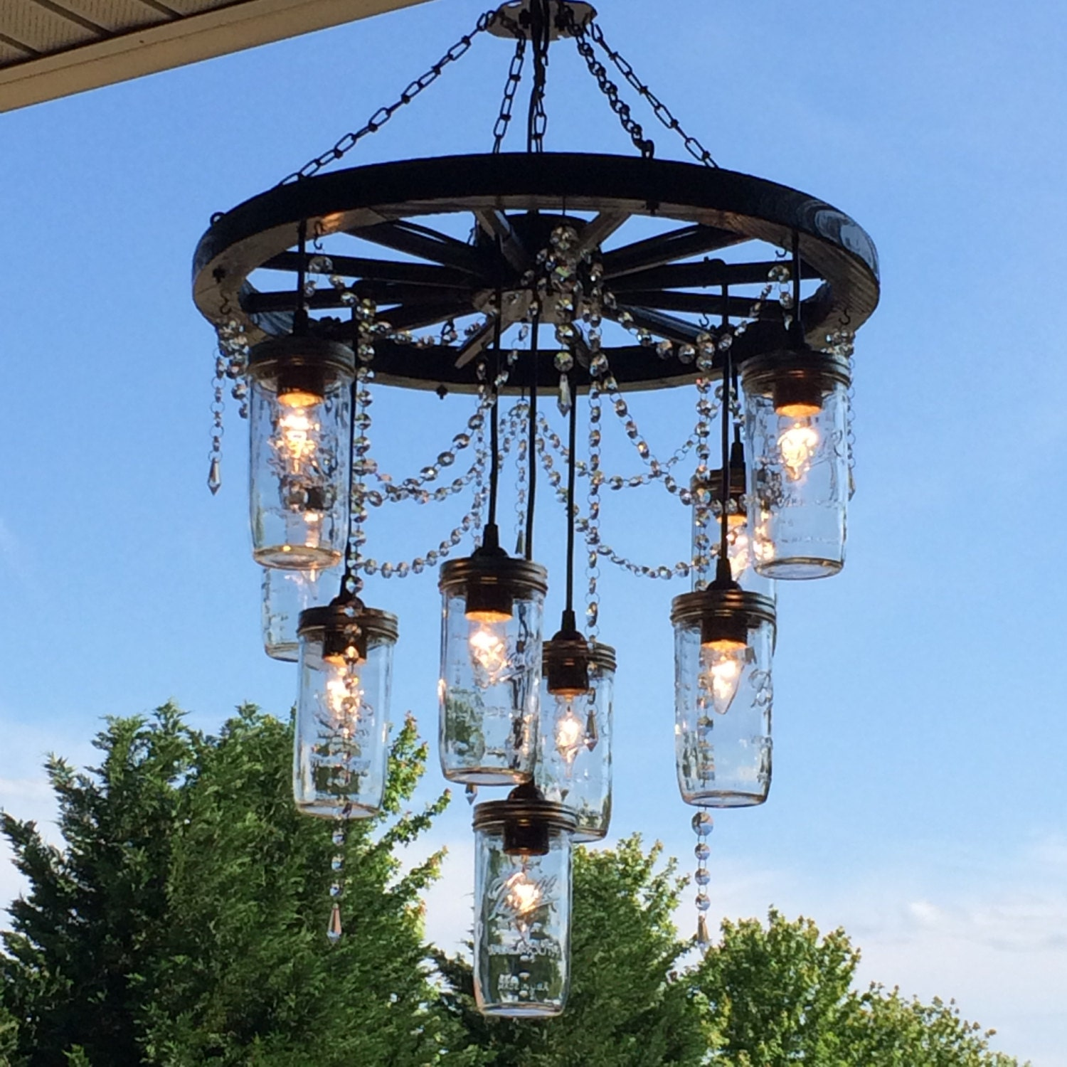Wagon Wheel Chandelier With 3 Tiers Of Mason Jar Lights