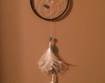 Teal and black feathered dreamcatcher